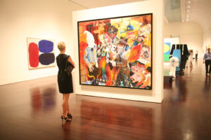 Woman looking at art at Blanton Museum